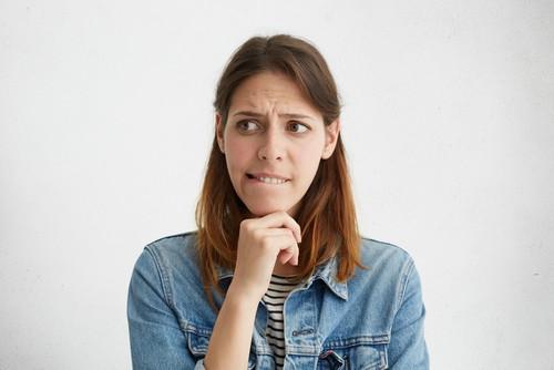 woman bites her lip